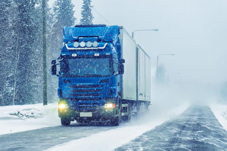 semi driving on highway in winter