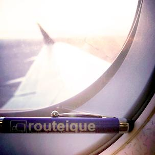 Routeique pen in the window of a plane.