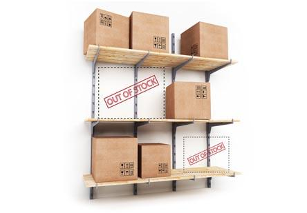"Three shelves against the wall with boxes and ""out of stock"" labels in the empty spaces."
