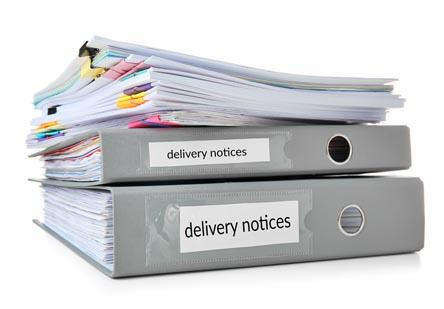 "Binders labelled ""delivery notices""."