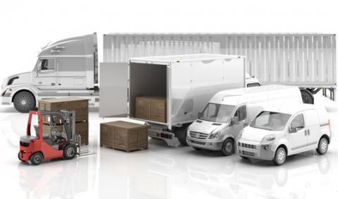 Various fleet and delivery vehicles parked together in a group - long haul semi truck, box truck, cargo van, sprinter van, and forklift loading boxes.