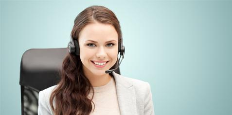 Smiling female with wireless headset on.